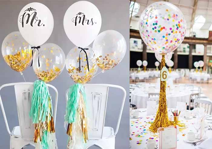 Transparent balloons with colorful scraps of paper inside as wedding decorations