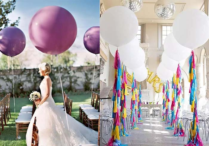 balloons decorate wedding aisle