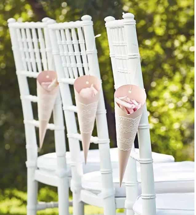 petal-decorated-chairs-on-wedding