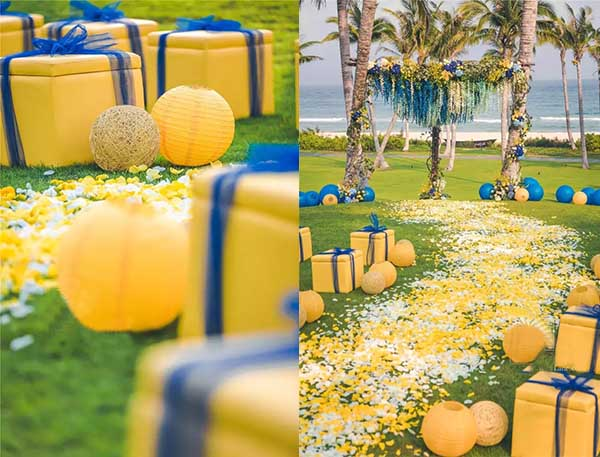 gift shaped yellow and blue chairs on wedding party
